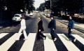 The Beatles walking across Abbey Road photo by Iain MacMillan