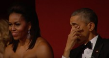 Michelle and Barack Obama watching Aretha Franklin
