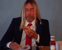Iggy Pop eats a hamburger