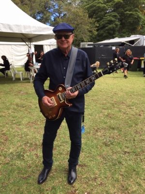 John Brewster of The Angels with the guitar made by his son Sam