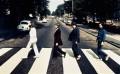 The Beatles walking across Abbey Road photo by Iain MacMillan